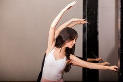 Practicing in a ballet barre Royalty Free Stock Photo