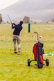 Practicing at driving range Stock Images