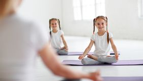 Practicing engaged in gymnastics and yoga with  teacher Royalty Free Stock Photo