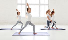 Practicing engaged in gymnastics and yoga with teacher Stock Image