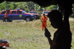 PRACTICING EVACUATION AND MEANS OF COMMUNICATION. A number of Members BASARNAS practice simulations with tracer radio communication and the search for victims at Stock Photo