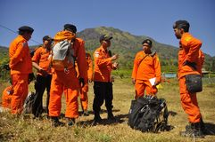 PRACTICING EVACUATION AND MEANS OF COMMUNICATION. A number of Members BASARNAS practice simulations with tracer radio communication and the search for victims at Stock Image
