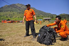 PRACTICING EVACUATION AND MEANS OF COMMUNICATION. A number of Members BASARNAS practice simulations with tracer radio communication and the search for victims at Royalty Free Stock Photo