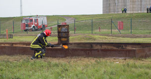Practicing fire ignited. Szeged, Algyo, Hungary - October 8, 2015: Regional fire-fighting exercise in the training area with urban and contract firefighters Royalty Free Stock Photos