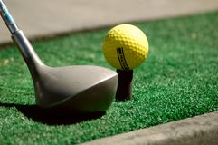 Practicing Golf. Club head and practice golf ball Stock Photos