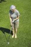 Practicing golf. Senior attractive woman practicing golf Stock Photos