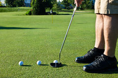 Practicing golf putting with several balls Royalty Free Stock Photo