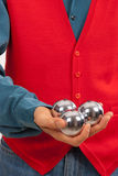 Practicing hand dexterity with three metal balls Stock Photos