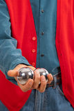 Practicing hand dexterity with two metal balls Stock Image