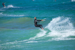 Practicing kitesurfing (kiteboarding) at the Corralejo Flag Beac Stock Image
