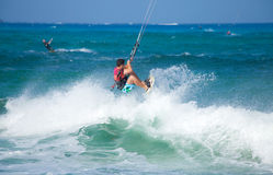 Practicing kitesurfing (kiteboarding) at the Corralejo Flag Beac Stock Photos