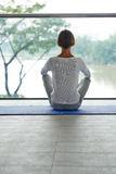 Practicing lotus position Royalty Free Stock Photography