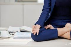 Practicing Meditation at Workplace stock photos