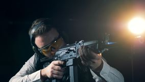 Practicing person stands with a assault rifle, close up. Kalashnikov assault rifle. stock video
