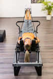 Practicing pilates. Healthy woman practicing pilates in exercise room Stock Photos