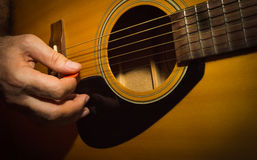 Practicing in playing guitar. Stock Image