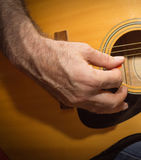 Practicing in playing guitar. Royalty Free Stock Image