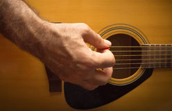 Practicing in playing guitar. Royalty Free Stock Photography