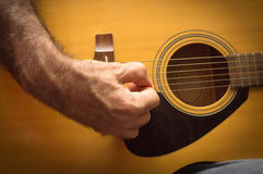 Practicing in playing guitar. Royalty Free Stock Photo