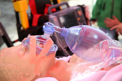 Practicing to use an oxygen mask on training doll Royalty Free Stock Photo