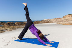 Practicing Yoga on the Beach Stock Photos