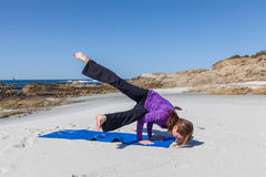 Practicing Yoga on the Beach Royalty Free Stock Photo
