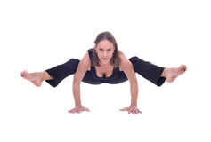 Practicing Yoga exercises / Arm balance yoga - doing split Stock Photo