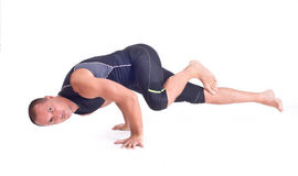 Practicing Yoga exercises:  Challenge Pose - Koundiyanasana Stock Photo
