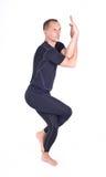 Practicing Yoga exercises / Eagle Pose - Garudasana Royalty Free Stock Images