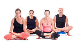 Practicing Yoga exercises in group / Scale Pose - Tolasana Royalty Free Stock Image