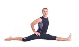 Practicing Yoga exercises:  Monkey Pose - Hanumanasana Royalty Free Stock Image
