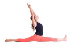 Practicing Yoga exercises / Monkey Pose - Hanumanasana Stock Image