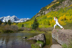Practicing Yoga at Maroon Bells in Autumn Stock Photo