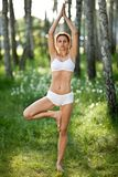 Practicing of yoga outdoors. Royalty Free Stock Image