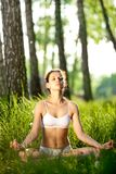 Practicing of yoga outdoors. royalty free stock photo