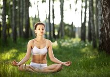 Practicing of yoga outdoors. Royalty Free Stock Photos