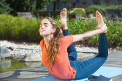 Practicing yoga outdoors Stock Photography