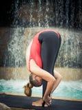 Practicing yoga. Padahastasana Stock Photography