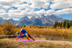 Practicing Yoga in the Tetons in Fall Stock Photo