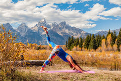 Practicing Yoga in the Tetons Stock Photo