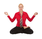 Practicing Yoga. Young businesswoman Royalty Free Stock Image