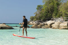 Practise paddle surf. Man practise paddle surf in Koh Lipe, Thailand Stock Photography
