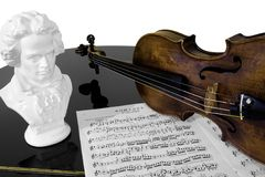 Practising Beethoven. A violin, score, and bust of Beethoven atop a piano, isolated against a white background Stock Photography