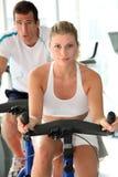 Practising fitness biking Royalty Free Stock Image