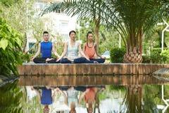 Practising lotus position royalty free stock photos