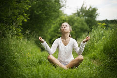 Practising yoga Royalty Free Stock Image