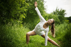 Practising yoga Stock Images