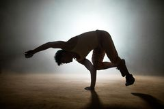Practitioner of dance doing specific moves of hip hop royalty free stock image