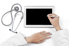 Practitioner hands with tablet and stethoscope Royalty Free Stock Images