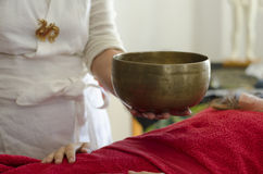 Practitioner  healing  with Tibetan singing bowls Royalty Free Stock Photo